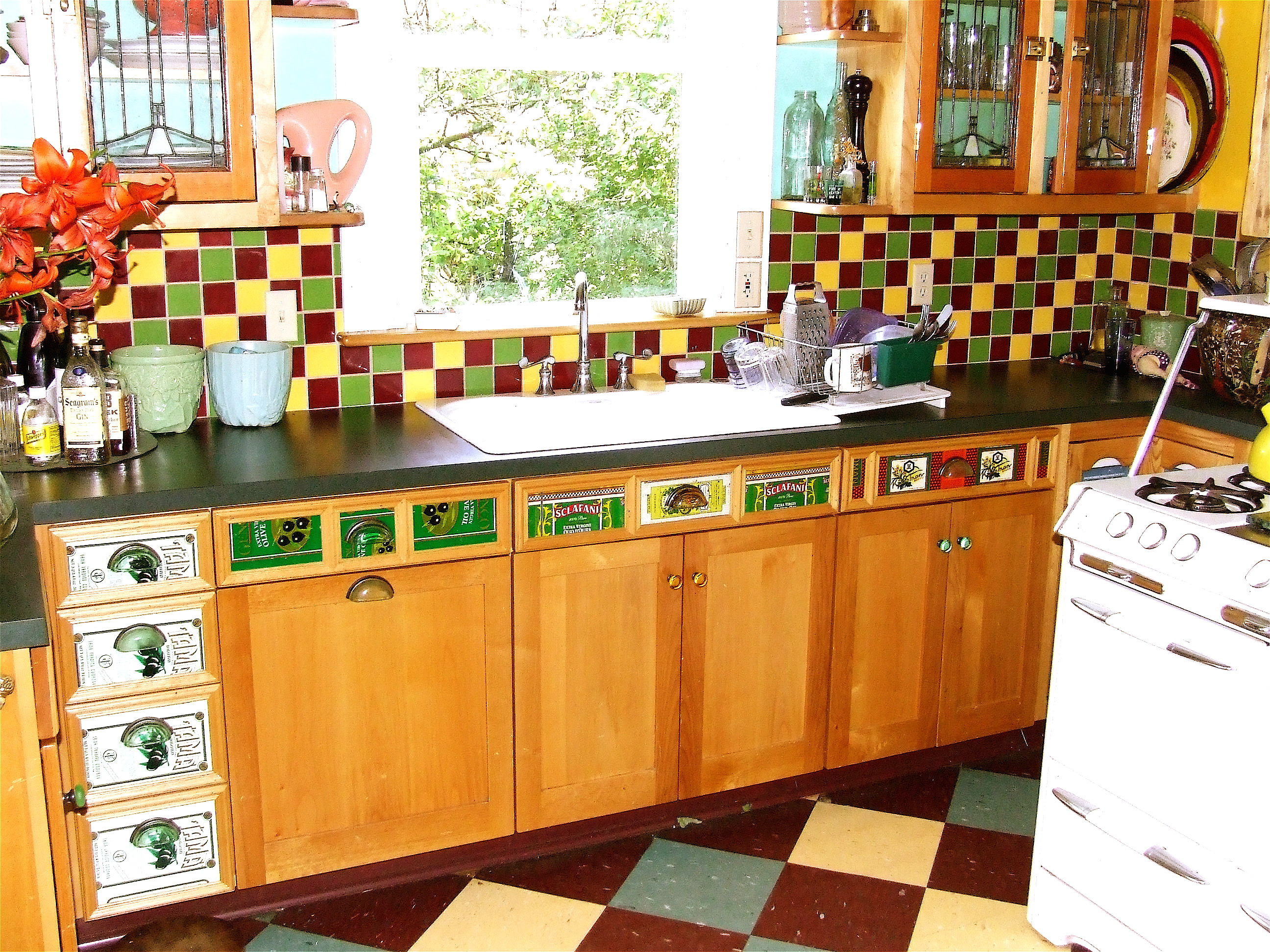 Alder Kitchen Cabinets with olive oil can drawer fronts